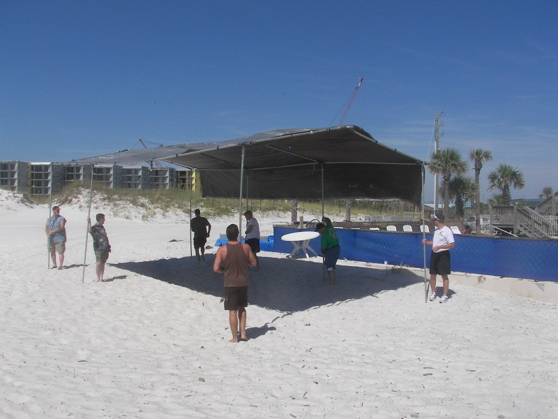 Classmates putting up shade at the beach